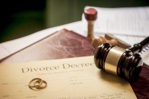 Divorce decree and wooden gavel